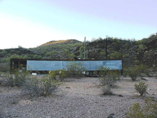 Abandoned structures can be ideal locations for concealing a tactical camp.  In this photo, six vehicles are parked behind an abandoned beehive that is about 100 yards away from a 2-track road.